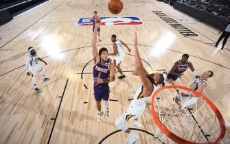 Orlando, FL - JULY 23: Devin Booker #1 of the Phoenix Suns shoots the ball during the game against the Utah Jazz during a scrimmage on July 23, 2020 at The Arena at ESPN Wide World of Sports in Orlando, Florida. NOTE TO USER: User expressly acknowledges and agrees that, by downloading and/or using this Photograph, user is consenting to the terms and conditions of the Getty Images License Agreement. Mandatory Copyright Notice: Copyright 2020 NBAE (Photo by Garrett Ellwood/NBAE via Getty Images)