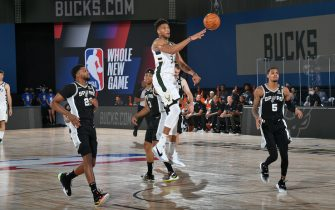 Orlando, FL - JULY 23: Giannis Antetokounmpo #34 of the Milwaukee Bucks passes the ball against the San Antonio Spurs during a scrimmage on July 23, 2020 at Visa Athletic Center at ESPN Wide World of Sports in Orlando, Florida. NOTE TO USER: User expressly acknowledges and agrees that, by downloading and/or using this Photograph, user is consenting to the terms and conditions of the Getty Images License Agreement. Mandatory Copyright Notice: Copyright 2020 NBAE (Photo by Jesse D. Garrabrant/NBAE via Getty Images)