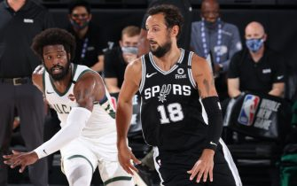ORLANDO, FL - JULY 23: Marco Belinelli #18 of the San Antonio Spurs drives to the basket against the Milwaukee Bucks on July 23, 2020 at the Visa Athletic Center at ESPN Wide World of Sports Complex in Orlando, Florida. NOTE TO USER: User expressly acknowledges and agrees that, by downloading and or using this photograph, User is consenting to the terms and conditions of the Getty Images License Agreement. Mandatory Copyright Notice: Copyright 2020 NBAE (Photo by David Sherman/NBAE via Getty Images)