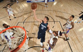 ORLANDO, FL - JULY 23: Boban Marjanovic #51 of the Dallas Mavericks grabs the rebound against the Los Angeles Lakers on July 23, 2020 at the Visa Athletic Center at ESPN Wide World of Sports Complex in Orlando, Florida. NOTE TO USER: User expressly acknowledges and agrees that, by downloading and or using this photograph, User is consenting to the terms and conditions of the Getty Images License Agreement. Mandatory Copyright Notice: Copyright 2020 NBAE (Photo by Jesse D. Garrabrant/NBAE via Getty Images)