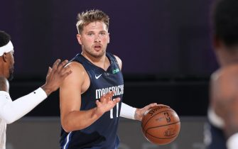 Orlando, FL - JULY 23: Luka Doncic #77 of the Dallas Mavericks handles the ball against the Los Angeles Lakers during a scrimmage on July 23, 2020 at Visa Athletic Center at ESPN Wide World of Sports in Orlando, Florida. NOTE TO USER: User expressly acknowledges and agrees that, by downloading and/or using this Photograph, user is consenting to the terms and conditions of the Getty Images License Agreement. Mandatory Copyright Notice: Copyright 2020 NBAE (Photo by David Sherman/NBAE via Getty Images)