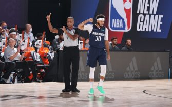 Orlando, FL - JULY 23: Seth Curry #30 of the Dallas Mavericks celebrates during a scrimmage against the Los Angeles Lakers on July 23, 2020 at Visa Athletic Center at ESPN Wide World of Sports in Orlando, Florida. NOTE TO USER: User expressly acknowledges and agrees that, by downloading and/or using this Photograph, user is consenting to the terms and conditions of the Getty Images License Agreement. Mandatory Copyright Notice: Copyright 2020 NBAE (Photo by David Sherman/NBAE via Getty Images)