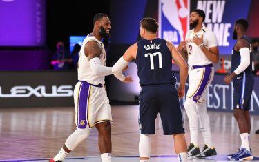 ORLANDO, FL - JULY 23: LeBron James #23 of the Los Angeles Lakers high-fives Luka Doncic #77 of the Dallas Mavericks before the game on July 23, 2020 at the Visa Athletic Center at ESPN Wide World of Sports Complex in Orlando, Florida. NOTE TO USER: User expressly acknowledges and agrees that, by downloading and or using this photograph, User is consenting to the terms and conditions of the Getty Images License Agreement. Mandatory Copyright Notice: Copyright 2020 NBAE (Photo by Jesse D. Garrabrant/NBAE via Getty Images)