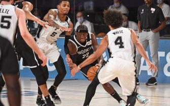 ORLANDO, FL - JULY 25: Caris LeVert #22 of the Brooklyn Nets drives to the basket against the San Antonio Spurs on July 25, 2020 in Orlando, Florida at The Arena at ESPN Wide World of Sports. NOTE TO USER: User expressly acknowledges and agrees that, by downloading and/or using this photograph, user is consenting to the terms and conditions of the Getty Images License Agreement. Mandatory Copyright Notice: Copyright 2020 NBAE (Photo by Garrett Ellwood/NBAE via Getty Images)