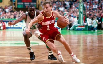 BOSTON, MA - 1993: Scott Brooks #1 of the Houston Rockets drives past Sherman Douglas #20 of the Boston Celtics during a game played at the Boston Garden in Boston, Massachusetts circa 1993. NOTE TO USER: User expressly acknowledges and agrees that, by downloading and or using this photograph, User is consenting to the terms and conditions of the Getty Images License Agreement. Mandatory Copyright Notice: Copyright 1993 NBAE (Photo by Dick Raphael/NBAE via Getty Images)