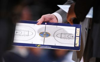 DENVER, CO - APRIL 9:  Head Coach Michael Malone of the Denver Nuggets holds the play board during the game against the Portland Trail Blazers on APRIL 9, 2018 at the Pepsi Center in Denver, Colorado. NOTE TO USER: User expressly acknowledges and agrees that, by downloading and/or using this Photograph, user is consenting to the terms and conditions of the Getty Images License Agreement. Mandatory Copyright Notice: Copyright 2018 NBAE (Photo by Garrett Ellwood/NBAE via Getty Images)