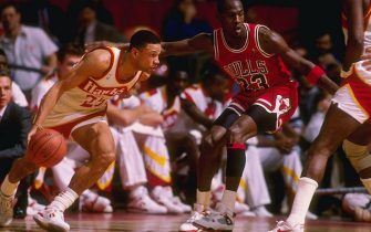 Guard Doc Rivers of the Atlanta Hawks tries to fend off guard Michael Jordan of the Chicago Bulls during a game at the Omni in Atlanta, Georgia.