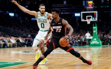 BOSTON, MASSACHUSETTS - DECEMBER 04: Jayson Tatum #0 of the Boston Celtics defends Jimmy Butler #22 of the Miami Heat during the first half of the game between the Boston Celtics and the Miami Heat at TD Garden on December 04, 2019 in Boston, Massachusetts. (Photo by Maddie Meyer/Getty Images)