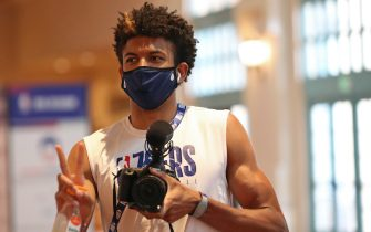 ORLANDO, FL - JULY 18: Matisse Thybulle #22 of the Philadelphia 76ers arrives with his camera during practice as part of the NBA Restart 2020 on July 18, 2020 in Orlando, Florida. NOTE TO USER: User expressly acknowledges and agrees that, by downloading and/or using this photograph, user is consenting to the terms and conditions of the Getty Images License Agreement.  Mandatory Copyright Notice: Copyright 2020 NBAE (Photo by Joe Murphy/NBAE via Getty Images)