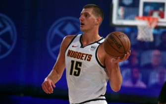 Orlando, FL - JULY 27: Nikola Jokic #15 of the Denver Nuggets passes the ball during the game against the Orlando Magic during a scrimmage on July 27, 2020 at The Arena at ESPN Wide World of Sports in Orlando, Florida. NOTE TO USER: User expressly acknowledges and agrees that, by downloading and/or using this Photograph, user is consenting to the terms and conditions of the Getty Images License Agreement. Mandatory Copyright Notice: Copyright 2020 NBAE (Photo by David Sherman/NBAE via Getty Images)