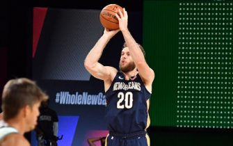 Orlando, FL - JULY 27: Nicolo Melli #20 of the New Orleans Pelicans shoots a three point basket during the game against the Milwaukee Bucks during a scrimmage on July 27, 2020 at The Arena at ESPN Wide World of Sports in Orlando, Florida. NOTE TO USER: User expressly acknowledges and agrees that, by downloading and/or using this Photograph, user is consenting to the terms and conditions of the Getty Images License Agreement. Mandatory Copyright Notice: Copyright 2020 NBAE (Photo by Jesse D. Garrabrant/NBAE via Getty Images)