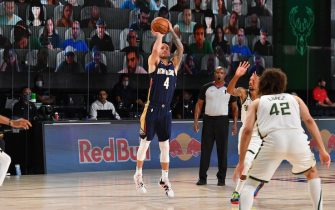 Orlando, FL - JULY 27: JJ Redick #4 of the New Orleans Pelicans shoots a three point basket during the game against the Milwaukee Bucks during a scrimmage on July 27, 2020 at The Arena at ESPN Wide World of Sports in Orlando, Florida. NOTE TO USER: User expressly acknowledges and agrees that, by downloading and/or using this Photograph, user is consenting to the terms and conditions of the Getty Images License Agreement. Mandatory Copyright Notice: Copyright 2020 NBAE (Photo by Jesse D. Garrabrant/NBAE via Getty Images)
