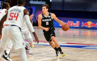 Orlando, FL - JULY 27: Bogdan Bogdanovic #8 of the Sacramento Kings handles the ball during the game against the LA Clippers during a scrimmage on July 27, 2020 at The Arena at ESPN Wide World of Sports in Orlando, Florida. NOTE TO USER: User expressly acknowledges and agrees that, by downloading and/or using this Photograph, user is consenting to the terms and conditions of the Getty Images License Agreement. Mandatory Copyright Notice: Copyright 2020 NBAE (Photo by Jesse D. Garrabrant/NBAE via Getty Images)