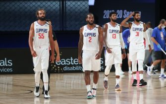 Orlando, FL - JULY 27: Joakim Noah #55, Kawhi Leonard #2, Paul George #13, and Marcus Morris Sr. #31 of the LA Clippers look on during a scrimmage against the Sacramento Kings on July 27, 2020 at The Arena at ESPN Wide World of Sports in Orlando, Florida. NOTE TO USER: User expressly acknowledges and agrees that, by downloading and/or using this Photograph, user is consenting to the terms and conditions of the Getty Images License Agreement. Mandatory Copyright Notice: Copyright 2020 NBAE (Photo by Joe Murphy/NBAE via Getty Images)