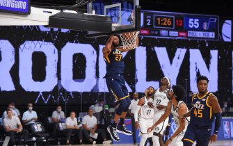 Orlando, FL - JULY 27:  Utah Jazz center Rudy Gobert #27 dunks the ball against the Brooklyn Nets during a scrimmage on July 27, 2020 at HP Field House at ESPN Wide World of Sports in Orlando, Florida. NOTE TO USER: User expressly acknowledges and agrees that, by downloading and/or using this Photograph, user is consenting to the terms and conditions of the Getty Images License Agreement. Mandatory Copyright Notice: Copyright 2020 NBAE (Photo by Bill Baptist/NBAE via Getty Images)