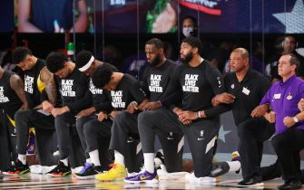 Orlando, FL - JULY 30: The Los Angeles Lakers kneel during the national anthem before the game against the LA Clippers during a game on July 30, 2020 at The Arena at ESPN Wide World Of Sports Complex in Orlando, Florida. NOTE TO USER: User expressly acknowledges and agrees that, by downloading and/or using this Photograph, user is consenting to the terms and conditions of the Getty Images License Agreement. Mandatory Copyright Notice: Copyright 2020 NBAE (Photo by Joe Murphy/NBAE via Getty Images)