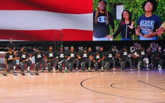 ORLANDO, FL - JULY 30: A wide view of the LA Clippers kneeling for the National Anthem before the game against the Los Angeles Lakers on July 30, 2020 in Orlando, Florida at The Arena at ESPN Wide World of Sports. NOTE TO USER: User expressly acknowledges and agrees that, by downloading and/or using this photograph, user is consenting to the terms and conditions of the Getty Images License Agreement.  Mandatory Copyright Notice: Copyright 2020 NBAE (Photo by Bill Baptist/NBAE via Getty Images)