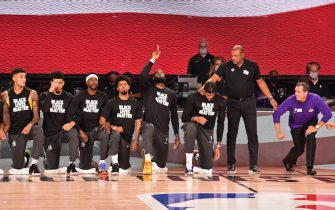 ORLANDO, FL - JULY 30:  LeBron James #23 of the Los Angeles Lakers points to the sky while kneeling for the National Anthem before the game against the LA Clippers on July 30, 2020 in Orlando, Florida at The Arena at ESPN Wide World of Sports. NOTE TO USER: User expressly acknowledges and agrees that, by downloading and/or using this photograph, user is consenting to the terms and conditions of the Getty Images License Agreement.  Mandatory Copyright Notice: Copyright 2020 NBAE (Photo by David Dow/NBAE via Getty Images)