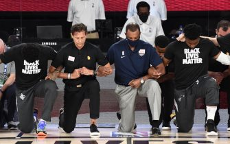 Orlando, FL - JULY 30: Quin Snyder of the Utah Jazz and Alvin Gentry of the New Orleans Pelicans kneel before the game on July 30, 2020 at The HP Field House at ESPN Wide World Of Sports Complex in Orlando, Florida. NOTE TO USER: User expressly acknowledges and agrees that, by downloading and/or using this Photograph, user is consenting to the terms and conditions of the Getty Images License Agreement. Mandatory Copyright Notice: Copyright 2020 NBAE (Photo by Garrett Ellwood/NBAE via Getty Images)