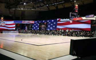 Orlando, FL - JULY 30: The New Orleans Pelicans and the Utah Jazz kneel for the National Anthem prior to a game on July 30, 2020 at HP Field House at ESPN Wide World of Sports in Orlando, Florida. NOTE TO USER: User expressly acknowledges and agrees that, by downloading and/or using this Photograph, user is consenting to the terms and conditions of the Getty Images License Agreement. Mandatory Copyright Notice: Copyright 2020 NBAE (Photo by David Sherman/NBAE via Getty Images)