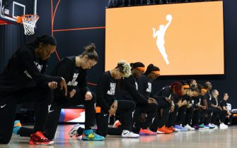PALMETTO, FL - JULY 28: The Connecticut Sun kneel for the National Anthem prior to a game against the Washington Mystics on July 28, 2020 at Feld Entertainment Center in Palmetto, Florida. NOTE TO USER: User expressly acknowledges and agrees that, by downloading and/or using this Photograph, user is consenting to the terms and conditions of the Getty Images License Agreement. Mandatory Copyright Notice: Copyright 2020 NBAE (Photo by Ned Dishman/NBAE via Getty Images)