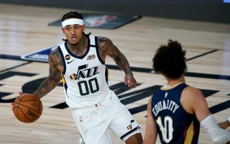 Utah Jazz's Jordan Clarkson (00) dribbles around New Orleans Pelicans' Jaxson Hayes (10) during the second half of an NBA basketball game Thursday, July 30, 2020, in Lake Buena Vista, Fla. (AP Photo/Ashley Landis, Pool)