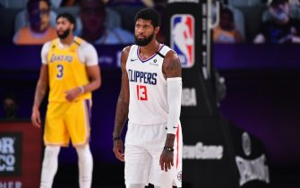 Orlando, FL - JULY 30: Paul George #13 of the LA Clippers looks on during a game against the Los Angeles Lakers on July 30, 2020 at The Arena at ESPN Wide World Of Sports Complex in Orlando, Florida. NOTE TO USER: User expressly acknowledges and agrees that, by downloading and/or using this Photograph, user is consenting to the terms and conditions of the Getty Images License Agreement. Mandatory Copyright Notice: Copyright 2020 NBAE (Photo by Jesse D. Garrabrant/NBAE via Getty Images)