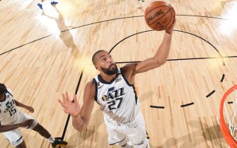 Orlando, FL - JULY 30: Rudy Gobert #27 of the Utah Jazz grabs the rebound during the game against the New Orleans Pelicans during a game on July 30, 2020 at The HP Field House at ESPN Wide World Of Sports Complex in Orlando, Florida. NOTE TO USER: User expressly acknowledges and agrees that, by downloading and/or using this Photograph, user is consenting to the terms and conditions of the Getty Images License Agreement. Mandatory Copyright Notice: Copyright 2020 NBAE (Photo by Garrett Ellwood/NBAE via Getty Images)