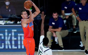 LAKE BUENA VISTA, FLORIDA - AUGUST 01: Danilo Gallinari #8 of the Oklahoma City Thunder shoots over Emmanuel Mudiay #15 of the Utah Jazz during the first half of an NBA basketball game on August 1, 2020 in Lake Buena Vista, Florida. NOTE TO USER: User expressly acknowledges and agrees that, by downloading and or using this photograph, User is consenting to the terms and conditions of the Getty Images License Agreement. (Photo by Ashley Landis - Pool/Getty Images)