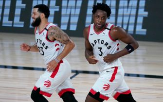 LAKE BUENA VISTA, FLORIDA - AUGUST 01: Fred VanVleet #23 and OG Anunoby #3 of the Toronto Raptors react after defeating the Los Angeles Lakers in an NBA basketball game at The Arena in the ESPN Wide World Of Sports Complex on August 1, 2020 in Lake Buena Vista, Florida. NOTE TO USER: User expressly acknowledges and agrees that, by downloading and or using this photograph, User is consenting to the terms and conditions of the Getty Images License Agreement. (Photo by Ashley Landis - Pool/Getty Images)
