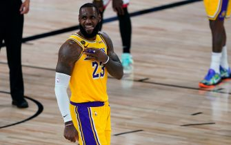LAKE BUENA VISTA, FLORIDA - AUGUST 01: LeBron James #23 of the Los Angeles Lakers celebrates a play during the second half of an NBA basketball game against the Toronto Raptors at The Arena in the ESPN Wide World Of Sports Complex on August 1, 2020 in Lake Buena Vista, Florida. NOTE TO USER: User expressly acknowledges and agrees that, by downloading and or using this photograph, User is consenting to the terms and conditions of the Getty Images License Agreement. (Photo by Ashley Landis - Pool/Getty Images)