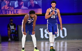 Orlando, FL - AUGUST 1: Joel Embiid #21 of the Philadelphia 76ers and Ben Simmons #25 of the Philadelphia 76ers look on during a game against the Indiana Pacers on August 1, 2020 at Visa Athletic Center at ESPN Wide World of Sports in Orlando, Florida. NOTE TO USER: User expressly acknowledges and agrees that, by downloading and/or using this Photograph, user is consenting to the terms and conditions of the Getty Images License Agreement. Mandatory Copyright Notice: Copyright 2020 NBAE (Photo by Jesse D. Garrabrant/NBAE via Getty Images)