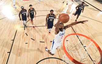 Orlando, FL - AUGUST 1: Kawhi Leonard #2 of the LA Clippers dunks the ball against the New Orleans Pelicans on August 1, 2020 at HP Field House at ESPN Wide World of Sports in Orlando, Florida. NOTE TO USER: User expressly acknowledges and agrees that, by downloading and/or using this Photograph, user is consenting to the terms and conditions of the Getty Images License Agreement. Mandatory Copyright Notice: Copyright 2020 NBAE (Photo by Garrett Ellwood/NBAE via Getty Images)