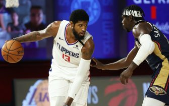 Orlando, FL - AUGUST 1: Paul George #13 of the LA Clippers handles the ball against the New Orleans Pelicans on August 1, 2020 at HP Field House at ESPN Wide World of Sports in Orlando, Florida. NOTE TO USER: User expressly acknowledges and agrees that, by downloading and/or using this Photograph, user is consenting to the terms and conditions of the Getty Images License Agreement. Mandatory Copyright Notice: Copyright 2020 NBAE (Photo by David Sherman/NBAE via Getty Images)