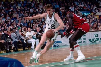 BOSTON, MA - 1980: Dave Cowens #18 of the Boston Celtics dribbles the ball against the Philadelphia 76ers during a game played circa 1980 at the Boston Garden in Boston, Massachussets. NOTE TO USER: User expressly acknowledges and agrees that, by downloading and or using this photograph, User is consenting to the terms and conditions of the Getty Images License Agreement. Mandatory Copyright Notice: Copyright 1980NBAE (Photo by Dick Raphael/NBAE via Getty Images)