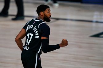 LAKE BUENA VISTA, FLORIDA - AUGUST 04: Garrett Temple #17 of the Brooklyn Nets celebrates a three-point basket in the closing seconds to defeat the Milwaukee Bucks 119-116 at Visa Athletic Center at ESPN Wide World Of Sports Complex on August 4, 2020 in Lake Buena Vista, Florida. NOTE TO USER: User expressly acknowledges and agrees that, by downloading and or using this photograph, User is consenting to the terms and conditions of the Getty Images License Agreement.  (Photo by Ashley Landis-Pool/Getty Images)