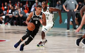 Orlando, FL - AUGUST 4: Timothe Luwawu-Cabarrot #9 of the Brooklyn Nets handles the ball during the game against the Milwaukee Bucks on August 4, 2020 at The Visa Athletic Center at ESPN Wide World Of Sports Complex in Reunion, Florida. NOTE TO USER: User expressly acknowledges and agrees that, by downloading and/or using this Photograph, user is consenting to the terms and conditions of the Getty Images License Agreement. Mandatory Copyright Notice: Copyright 2020 NBAE (Photo by Joe Murphy/NBAE via Getty Images)