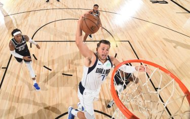Orlando, FL - AUGUST 4: Luka Doncic #77 of the Dallas Mavericks goes up for a dunk against the Sacramento Kings on August 4, 2020 at The Arena at ESPN Wide World of Sports in Orlando, Florida. NOTE TO USER: User expressly acknowledges and agrees that, by downloading and/or using this Photograph, user is consenting to the terms and conditions of the Getty Images License Agreement. Mandatory Copyright Notice: Copyright 2020 NBAE (Photo by Garrett Ellwood/NBAE via Getty Images)