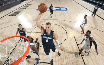 ORLANDO, FL - AUGUST 6: Kristaps Porzingis #6 of the Dallas Mavericks dunks the ball against the LA Clippers on August 6, 2020 at the HP Field House at ESPN Wide World of Sports in Orlando, Florida. NOTE TO USER: User expressly acknowledges and agrees that, by downloading and/or using this Photograph, user is consenting to the terms and conditions of the Getty Images License Agreement. Mandatory Copyright Notice: Copyright 2020 NBAE (Photo by David Sherman/NBAE via Getty Images)