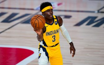 Indiana Pacers guard Aaron Holiday (3) makes a pass against the Orlando Magic during the first half of an NBA basketball game Tuesday, Aug. 4, 2020 in Lake Buena Vista, Fla. (AP Photo/Ashley Landis)