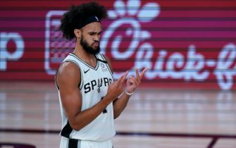 LAKE BUENA VISTA, FLORIDA - AUGUST 02:   Derrick White #4 of the San Antonio Spurs looks at his hands after a play against the Memphis Grizzlies during the first half of an NBA basketball game at Visa Athletic Center at ESPN Wide World Of Sports Complex on August 2, 2020 in Lake Buena Vista, Florida. NOTE TO USER: User expressly acknowledges and agrees that, by downloading and or using this photograph, User is consenting to the terms and conditions of the Getty Images License Agreement. (Photo by Ashley Landis-Pool/Getty Images)