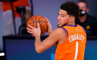 LAKE BUENA VISTA, FLORIDA - AUGUST 06: Devin Booker #1 of the Phoenix Suns drives the ball during the third quarter against the Indiana Pacers at Visa Athletic Center at ESPN Wide World Of Sports Complex on August 06, 2020 in Lake Buena Vista, Florida. NOTE TO USER: User expressly acknowledges and agrees that, by downloading and or using this photograph, User is consenting to the terms and conditions of the Getty Images License Agreement. (Photo by Kevin C. Cox/Getty Images)