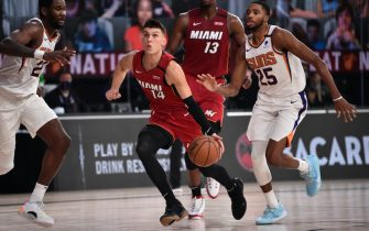 Orlando, FL - AUGUST 8: Tyler Herro #14 of the Miami Heat handles the ball against the Phoenix Suns on August 8, 2020 at Visa Athletic Center at ESPN Wide World of Sports in Orlando, Florida. NOTE TO USER: User expressly acknowledges and agrees that, by downloading and/or using this Photograph, user is consenting to the terms and conditions of the Getty Images License Agreement. Mandatory Copyright Notice: Copyright 2020 NBAE (Photo by David Dow/NBAE via Getty Images)