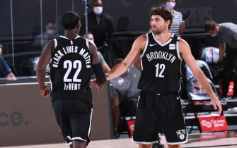 Orlando, FL - AUGUST 9: Joe Harris #12 of the Brooklyn Nets high five his teammate during the game against the LA Clippers on August 9, 2020 at AdventHealth Arena in Orlando, Florida. NOTE TO USER: User expressly acknowledges and agrees that, by downloading and/or using this Photograph, user is consenting to the terms and conditions of the Getty Images License Agreement. Mandatory Copyright Notice: Copyright 2020 NBAE (Photo by Garrett Ellwood/NBAE via Getty Images)