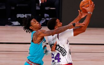LAKE BUENA VISTA, FLORIDA - AUGUST 09: Ja Morant #12 of the Memphis Grizzlies tries to block a shot by Norman Powell #24 of the Toronto Raptors during the second quarter at Visa Athletic Center at ESPN Wide World Of Sports Complex on August 09, 2020 in Lake Buena Vista, Florida. NOTE TO USER: User expressly acknowledges and agrees that, by downloading and or using this photograph, User is consenting to the terms and conditions of the Getty Images License Agreement. (Photo by Kevin C. Cox/Getty Images)