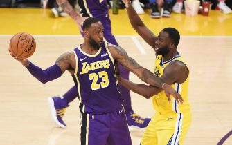LOS ANGELES, CA - NOVEMBER 13: LeBron James #23 of the Los Angeles Lakers handles the ball against Draymond Green #23 of the Golden State Warriors on November 13, 2019 at STAPLES Center in Los Angeles, California. NOTE TO USER: User expressly acknowledges and agrees that, by downloading and/or using this Photograph, user is consenting to the terms and conditions of the Getty Images License Agreement. Mandatory Copyright Notice: Copyright 2019 NBAE (Photo by Adam Pantozzi/NBAE via Getty Images)