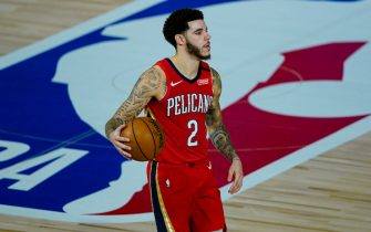 New Orleans Pelicans' Lonzo Ball (2) brings the ball up court against the Memphis Grizzlies during the second half of an NBA basketball game Monday, Aug. 3, 2020 in Lake Buena Vista, Fla. (AP Photo/Ashley Landis, Pool)
