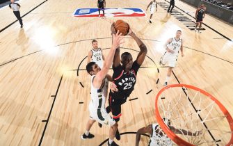 Orlando, FL - AUGUST 10: Chris Boucher #25 of the Toronto Raptors dunks the ball against the Milwaukee Bucks on August 10, 2020 at The Field House at ESPN Wide World Of Sports Complex in Orlando, Florida. NOTE TO USER: User expressly acknowledges and agrees that, by downloading and/or using this Photograph, user is consenting to the terms and conditions of the Getty Images License Agreement. Mandatory Copyright Notice: Copyright 2020 NBAE (Photo by Joe Murphy/NBAE via Getty Images)