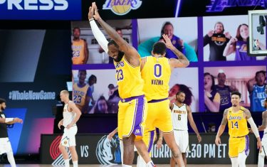Orlando, FL - AUGUST 10: LeBron James #23 of the Los Angeles Lakers and Kyle Kuzma #0 of the Los Angeles Lakers react after a game winning shot against the Denver Nuggets on August 10, 2020 at the AdventHealth Arena at in Orlando, Florida. NOTE TO USER: User expressly acknowledges and agrees that, by downloading and/or using this Photograph, user is consenting to the terms and conditions of the Getty Images License Agreement. Mandatory Copyright Notice: Copyright 2020 NBAE (Photo by Jesse D. Garrabrant/NBAE via Getty Images)