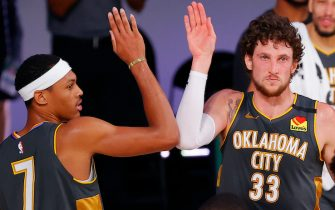 LAKE BUENA VISTA, FLORIDA - AUGUST 12:  Mike Muscala #33 of the Oklahoma City Thunder celebrates with teammate Darius Bazley #7 after sinking the game winning three point basket against the Miami Heat during the fourth quarter at Visa Athletic Center at ESPN Wide World Of Sports Complex on August 12, 2020 in Lake Buena Vista, Florida. NOTE TO USER: User expressly acknowledges and agrees that, by downloading and or using this photograph, User is consenting to the terms and conditions of the Getty Images License Agreement. (Photo by Kevin C. Cox/Getty Images)